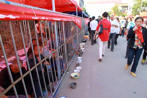 Photo of China beggars caged during temple fair